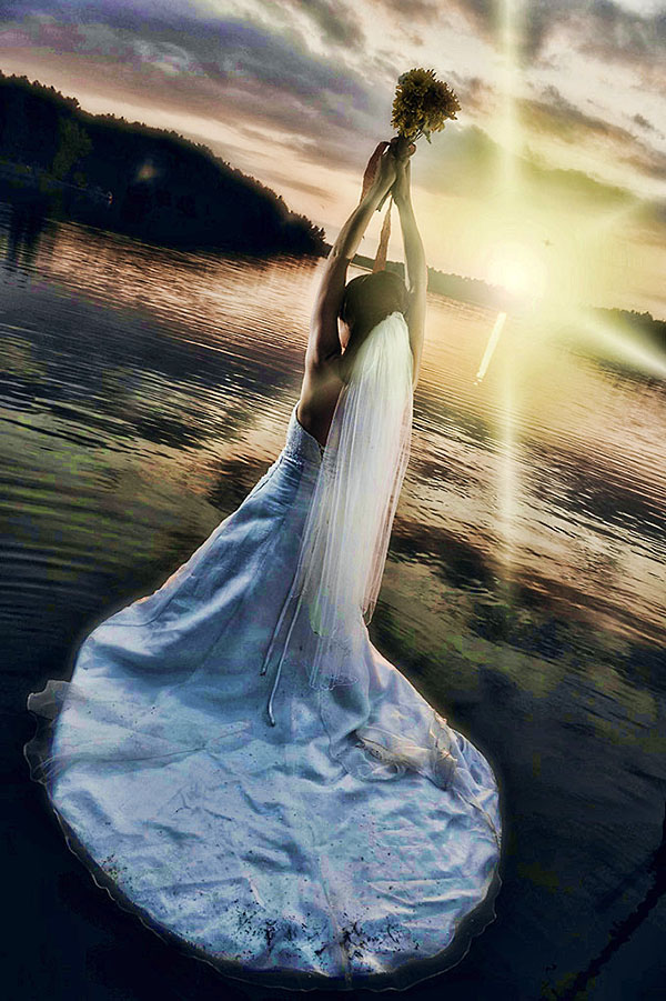 bride in water at sunset